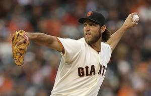 Photo - San Francisco Giants' Madison Bumgarner works against the Washington Nationals in the first inning of a baseball game Tuesday, June 10, 2014, in San Francisco. (AP Photo/Ben Margot)