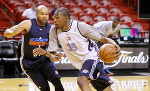 Photo - Oklahoma City's Kevin Durant drives past Oklahoma City's Derek Fisher, left, during practice for Game 3 of the NBA Finals between the Oklahoma City Thunder and the Miami Heat at American Airlines Arena in Miami, Saturday, June 16, 2012. Photo by Bryan Terry, The Oklahoman
