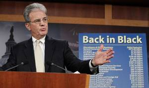 "Photo - Sen. Tom Coburn, R-Okla., reveals his ""Back in Black"" plan to reduce the federal deficit, Monday, July 18, 2011, during a news conference on Capitol Hill in Washington. (AP Photo/J. Scott Applewhite) ORG XMIT: DCSA104"