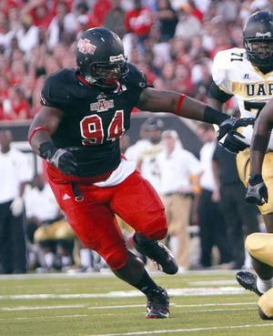 Photo - In this photo taken on Aug. 31, 2013, and released by Arkansas State,  Arkansas State defensive lineman Markel Owens rushing against Arkansas-Little Rock during an NCAA college football game in Jonesboro, Ark. Authorities said Thursday, Jan. 16, 214, that Owens was one of two men shot to death during a home invasion robbery in Jackson, Tenn., Wednesday night. (AP Photo/Arkansas State)
