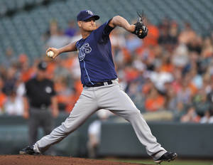 Photo - Tampa Bay Rays pitcher Alex Cobb delivers against the Baltimore Orioles in the first inning of a baseball game, Tuesday, Aug. 20, 2013, in Baltimore.(AP Photo/Gail Burton)