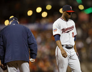 Photo - Minnesota Twins pitcher Samuel Deduno is taken out of the baseball game by manager Ron Gardenhire, left, during the sixth inning against the San Francisco Giants on Saturday, May 24, 2014, in San Francisco. (AP Photo/Tony Avelar)