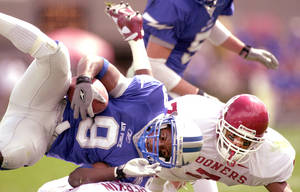 Photo - OU COLLEGE FOOTBALL: Oklahoma football against Air Force in Colorado Springs, Colorado Saturday September 1, 2001. Brandon Everage puts hit on Leotis Palmer in the first half. Staff photo by Bryan Terry