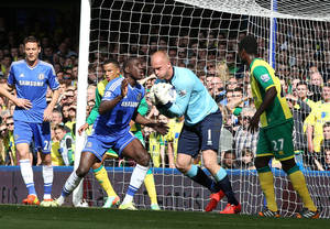 Photo - Chelsea's Demba Ba, center left, reacts as Norwich City's goalkeeper John Ruddy collects the ball after a header from Chelsea's John Terry during their English Premier League soccer match at Stamford Bridge stadium in London Sunday May 4, 2014. (AP Photo/Alastair Grant)