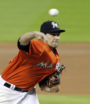 Photo - Miami Marlins' Nate Eovaldi pitches against the San Diego Padres in the first inning of a baseball game in Miami, Sunday, April 6, 2014. (AP Photo/Alan Diaz)