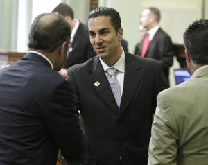 Photo - FILE –– In this June 10, 2010 file photo, Assemblyman Mike Gatto, D– Los Angeles, center, receives congratulations from Assemblyman Jerry Hill, D–San Mateo, left, after he was sworn–in to the state Assembly at the Capitol in Sacramento, Calif. Gatto was critical of Controller John Chiang's decision to not pay members of the Legislature for not approving a balanced budget by the June 15th deadline. Chiang said that he found the budget plan passed by Democrats on a simple majority vote last week was not balanced and therefore lawmakers did not meet the requirement for getting paid under Proposition 25, passed by the voters in November.(AP Photo/Rich Pedroncelli, file)