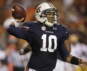 photo -   FILE - This Sept. 22, 2012 file photo shows Auburn quarterback Kiehl Frazier (10) looking for a receiver in the second half of an NCAA college football game against LSU, in Auburn, Ala. Frazier has been shaky all season, unable to produce big plays or avoid turnovers. The good news for Frazier: He also hasn't faced a struggling pass defense like he'll see when his home state team, Arkansas, visits. (AP Photo/Dave Martin, File)