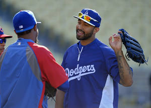 Photo - Los Angeles Dodgers' Matt Kemp, right, talks with Chicago Cubs' Edwin Jackson during batting practice prior to their baseball game, Tuesday, Aug. 27, 2013, in Los Angeles.  (AP Photo/Mark J. Terrill)