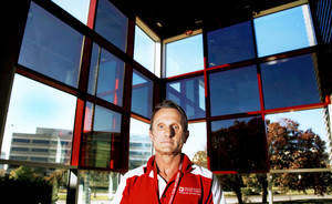 photo - American Red Cross volunteer Steve Klapp stands Friday in the Red Cross office in Oklahoma City.  Photo by Chris Landsberger, The Oklahoman