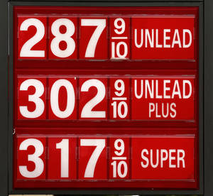 Photo - Posted gas prices Tuesday at a Britton Rd. and Pennsylvania Ave. station in north Oklahoma City. <strong>Jim Beckel - THE OKLAHOMAN</strong>