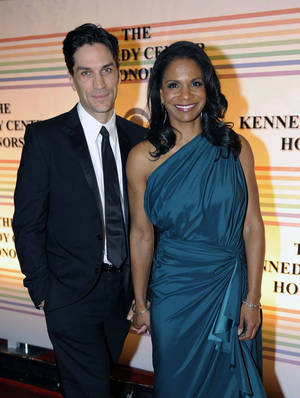 Photo -   FILE - In this Dec. 4, 2011 file photo, actress Audra McDonald, right, and actor Will Swenson arrive at the Kennedy Center for the Performing Arts for the Kennedy Center Honor gala performance in Washington. Audra McDonald and Will Swenson were married today, Saturday, Oct. 6, 2012 at their home in Croton-on-Hudson, New York. (AP Photo/Kevin Wolf, file)