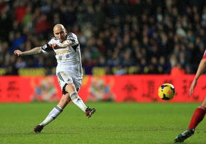 Photo - Swansea City's Jonjo Shelvey scores his side's first goal of the game during the English Premier League soccer match at the Liberty Stadium, Swansea, Wales, Tuesday, Jan. 28, 2014. (AP Photo/Nick Potts, PA Wire)   UNITED KINGDOM OUT   -  NO SALES  -  NO ARCHIVES