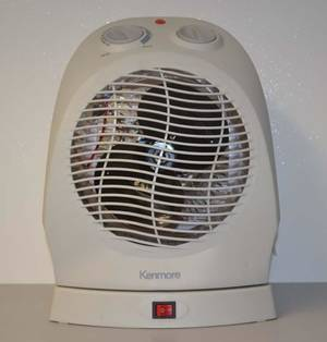 Photo - This photo provided by the U.S. Consumer Product Safety Commission shows a Kenmore Oscillating Fan Heater.  The heater is being recalled due to Fire and Burn Hazards. (AP Photo/U.S. Consumer Product Safety Commission)