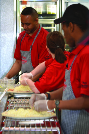 Photo - Charles Cooperwood, left, prepares pizzas with other employees at a Papa Murphy's store. The franchise will be staffed with employees with disabilties in partnership with the Dale Rogers Training Center.  <strong> - PROVIDED</strong>
