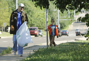Photo -  Ben Henke and Lucas Henke, 9, pick up trash along Boulevard during Operation Clean Community in Edmond. PHOTO BY PAUL HELLSTERN, THE OKLAHOMAN  <strong>PAUL HELLSTERN -   </strong>