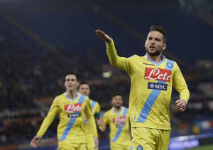 Photo - Napoli's Dries Mertens right celebrates after scoring  during an Italian Cup, semifinal first leg match, between AS Roma and Napoli at Rome's Olympic stadium, Wednesday, Feb. 5, 2014. (AP Photo/Alessandra Tarantino)