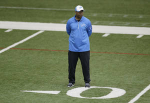Photo - Detroit Lions head coach Jim Caldwell observes team drills at the Lions training facility in Allen Park, Mich., Tuesday, April 22, 2014. (AP Photo/Carlos Osorio)