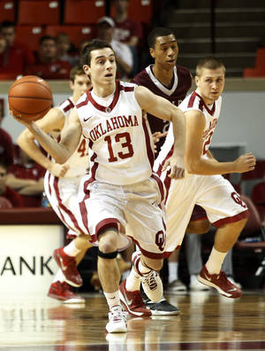 Photo - Oklahoma's James Fraschilla (13) passes the ball downcourt during a mens basketball game between OU and UALR at Lloyd Noble Center in Norman, Okla., Friday, Nov. 29, 2013.  Photo by Garett Fisbeck, For The Oklahoman