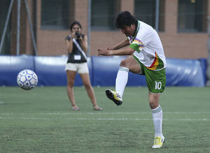 Photo - FILE- Inthis Sept. 5, 2013 file photo, Bolivia President Evo Morales kicks the ball during an exhibition soccer match in Bergamo, near Milan, Italy. A first-division Bolivian soccer club said May 18, 2014, that President Morales will suit up for the team and play about 20-30 minutes per match. Morales has not yet commented on the new gig, in which he's to receive minimum wage, or $213. (AP Photo/Antonio Calanni, File)