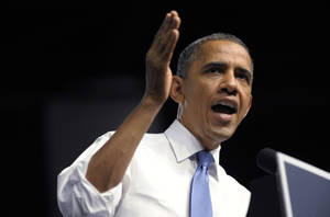 Photo -   President Barack Obama speaks at a campaign event at the Prime Osborn Convention Center in Jacksonville, Fla., Thursday, July 19, 2012. Obama is spending two days in Florida campaigning. (AP Photo/Susan Walsh)