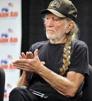 Photo - Willie Nelson attends a news conference prior to the start of the Farm Aid 2013 concert at Saratoga Performing Arts Center in Saratoga Springs, N.Y., Saturday, Sept. 21, 2013. (AP Photo/Hans Pennink)