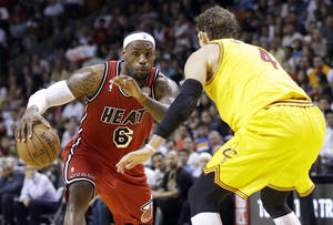photo - Miami Heat forward LeBron James (6) drives to the basket against Cleveland Cavaliers forward Luke Walton (4) during the first half of an NBA basketball game, Sunday, Feb. 24, 2013, in Miami. (AP Photo/Wilfredo Lee)