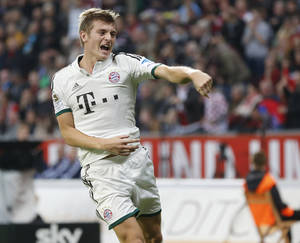 Photo - Bayern's Toni Kroos celebrates his side's opening goal during a German first division Bundesliga soccer match between Bayer Leverkusen and Bayern Munich in Leverkusen, Saturday, Oct.5, 2013. (AP Photo/Michael Probst)