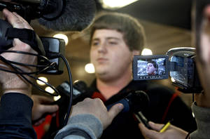 Photo - Mustang High School's Bronson Irwin is talks to the media after signing to play football for the University of Oklahoma (OU) at Mustang High School on Wednesday, Feb. 3, 2010, in Mustang, Okla.   Photo by Chris Landsberger, The Oklahoman