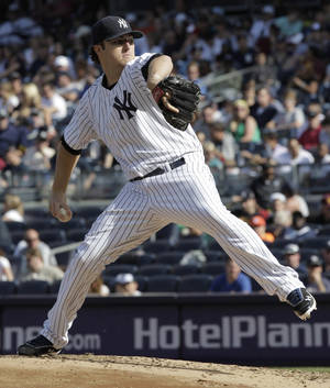 Photo -   New York Yankees pitcher Phil Hughes throws in the third inning of a baseball game against the Seattle Mariners on Saturday, May 12, 2012 in New York. (AP PhotoPeter Morgan)