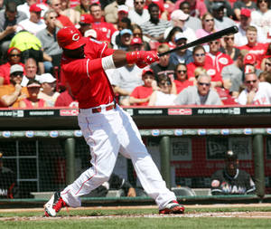 photo -   CORRECTS TO CAREER HIT WITH THE REDS, NOT JUST CAREER HIT - Cincinnati Reds' Brandon Phillips (4) gets his 1,000th career hit with the Reds, in the second inning of a baseball game against the Miami Marlins on Sunday, April 9, 2012, in Cincinnati. (AP Photo/Ernest Coleman)