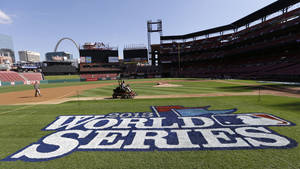 Photo - Grounds crew workers prepare the field before a baseball practice, Friday, Oct. 25, 2013, in St. Louis. The St. Louis Cardinals and Boston Red Sox are set to play Game 3 of the World Series on Saturday in St. Louis. (AP Photo/Charlie Neibergall)