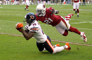 Photo - Chicago Bears wide receiver Brandon Marshall (15) can't hold onto the pass as Arizona Cardinals cornerback Patrick Peterson (21) defends during the first half of an NFL football game, Sunday, Dec. 23, 2012, in Glendale, Ariz. (AP Photo/Paul Connors)