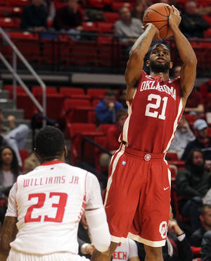 photo - Oklahoma's Cameron Clark (21) shoots over Texas Tech's Jamal Williams during their NCAA college basketball game in Lubbock, Texas, Wednesday, Feb. 20, 2013. (AP Photo/The Avalanche-Journal, Stephen Spillman) ALL LOCAL TV OUT ORG XMIT: TXLUB110
