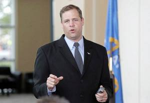Photo - First district US Congressman Jim Bridenstine talks with constituents at the Glenpool Chamber of Commerce luncheon in Glenpool, OK, June 3, 2014. STEPHEN PINGRY/Tulsa World