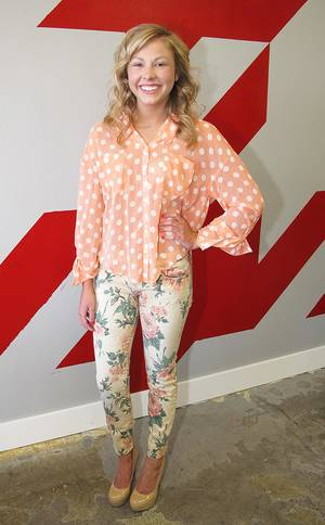 Photo - A model wears a Free People polka dot blouse ($86) and Current/Elliott floral print jeans ($214). (Sara Glassman/Minneapolis Star Tribune/MCT)