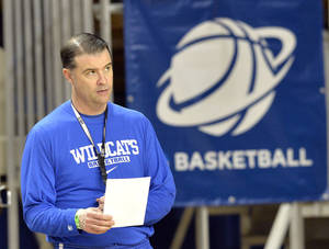 Photo - Kentucky head coach Matthew Mitchell looks on during practice for the NCAA women's college basketball tournament in Lexington, Ky., Friday, March 21, 2014. Kentucky plays Wright State in a first-round game Saturday.  (AP Photo/Timothy D. Easley)