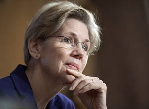 photo - Sen. Elizabeth Warren, D-Mass., listens to a witness at Senate Banking Committee hearing on anti-money laundering on Capitol Hill in Washington, Thursday, March 7, 2013. Warren rose to national prominence as an outspoken consumer advocate decrying Wall Street abuses and became the progressive movement's darling candidate in last fall's Senate elections. Like most freshman lawmakers, the Massachusetts Democrat has maintained a low profile during her first few months in office, but that's starting to change. (AP Photo/Cliff Owen)