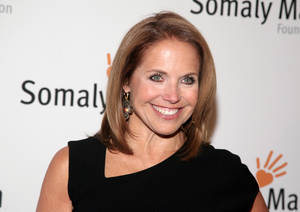 "Photo - FILE - This Oct. 23, 2013 file photo shows TV host Katie Couric at the Somaly Mam Foundation Gala in New York. Couric is joining Yahoo to anchor a news program for the Internet company as it tries to expand its audience and sell more advertising. An announcement on Monday, Nov. 25, confirms recent published reports that Couric would diversify into online video programming after spending decades in broadcast television as a talk-show host and news anchor. The 56-year-old Couric will continue to host her daytime talk show, ""Katie,"" on ABC even after she becomes Yahoo's ""global anchor"" beginning next year. (Photo by Andy Kropa/Invision/AP, File)"