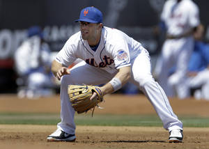 Photo - New York Mets third baseman David Wright works at his position during the second inning of an exhibition spring training baseball game against the St. Louis Cardinals Friday, March 29, 2013, in Port St. Lucie, Fla. (AP Photo/Jeff Roberson)