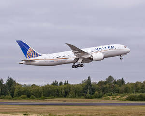 Photo -   In this undated photo provided by Boeing Commercial Airplanes, the first Boeing 787 that will be used by United Airlines, is shown taking off. U.S. travelers are going to be seeing a lot more of the 787, the ultra-lightweight jet that aims to reduce flier fatigue and airline fuel bills. United announced the week ofThursday, Sept. 27, 2012, that it has become the first U.S. airline to get the newest Boeing plane, and flights from Houston to Chicago will begin November 4. The carrier joins All Nippon Airlines and Japan Airlines, who have started 787 service from U.S. cities, or will soon. (AP Photo/Boeing, Matthew Thompson)