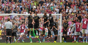 Photo - Aston Villa's Leandro Bacuna , second right, scores his side's second goal,  during the English Premier League match against Manchester City,  at Villa Park, in Birmingham, England,  Saturday Sept.  28, 2013. (AP Photo/PA, Jon Buckle) UNITED KINGDOM OUT