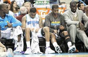 Photo - The Hornets' Marcus Thornton, left, and Chris Paul. AP photo