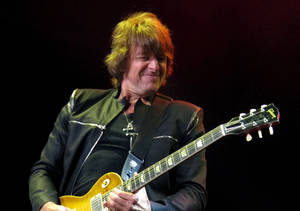 """Photo -   FILE - This May 20, 2012 file photo shows Bon Jovi guitarist Richie Sambora performing at the Bamboozle Festival in Asbury Park N.J. Sambora's solo release """"Aftermath of Lowdown"""" covers a lot of personal ground for the rocker including his much-publicized divorce from Heather Locklear, his ongoing battle with alcohol and substance abuse, and the virtues of being a parent. (AP Photo/Wayne Parry, file)"""