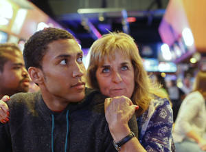 Photo -  Former C.M. Russell and Stanford basketball player, Josh Huestis, left, and his mother, Bonnie, watch the NBA Draft at the Sting Sports Bar Thursday. PHOTO BY LARRY BECKNER, Courtesy The Great Falls (Mont.) Tribune  <strong> -   </strong>