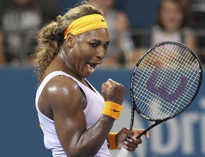 Photo - Serena Williams of the U.S. celebrates upon beating Maria Sharapova of Russia 6-2, 7-6 in their semifinal match during the Brisbane International tennis tournament in Brisbane, Australia, Friday, Jan. 3, 2014. (AP Photo/Tertius Pickard)