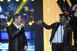 "Photo - Jermaine Paul, right, a finalist of Season 2 of ""The Voice,"" performs the R&B classic ""Soul Man"" with his coach, Oklahoma country music star Blake Shelton. Paul went on to win the title of ""The Voice"" on the hit reality TV show. Photo by Lewis Jacobs/NBC <strong>NBC</strong>"