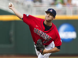 Photo -   Arizona starting pitcher Konner Wade delivers against UCLA in the first inning of an NCAA College World Series baseball game in Omaha, Neb., Sunday, June 17, 2012. (AP Photo/Nati Harnik)
