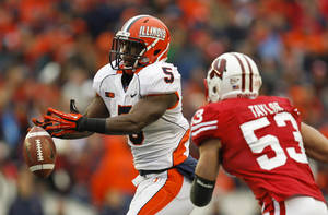 Photo -   Illinois' Donovonn Young (5) cannot hang on to a pass against Wisconsin linebacker Mike Taylor during the second half of an NCAA college football game on Saturday, Oct. 6, 2012, in Madison, Wis. (AP Photo/Andy Manis)
