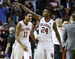 Oklahoma guard Isaiah Cousins (11) and guard Buddy Hield (24) celebrate after a recent victory. (AP Photo)
