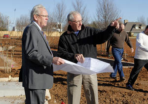 Photo - Kelly McNitt, left, one of the developers of Glenbrook Park, looks over the site in Nichols Hills with Huitt-Zollars civil engineer Clyde Wilkens. Photo by PAUL HELLSTERN, The Oklahoman